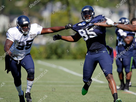 Benson Mayowa, Anthony McCoy Seattle Seahawks' Benson Mayowa (95) grabs Anthony McCoy during a drill at NFL football camp practice, in Renton, Wash