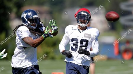 Richard Sherman, Terrell Thomas Seattle Seahawks' Richard Sherman, left, reaches for the ball in front of Terrell Thomas at an NFL football camp practice, in Renton, Wash