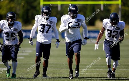 A.J. Jefferson, Jeron Johnson, Dion Bailey, Phillip Adams Seattle Seahawks' Phillip Adams (28), Dion Bailey (37), Jeron Johnson and A.J. Jefferson (32) line-up at an NFL football camp practice, in Renton, Wash