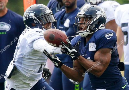 Percy Harvin Seattle Seahawks wide receiver Percy Harvin, right, makes a catch as cornerback Terrell Thomas, left, defends, during practice drills, at NFL football training camp in Renton, Wash