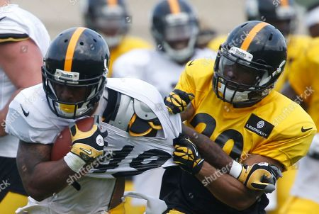 Jordan Hall, Devin Smith Pittsburgh Steelers running back Jordan Hall (49) gets his jersey pulled by cornerback Devin Smith as he runs the ball during NFL football training camp in Latrobe, Pa., on