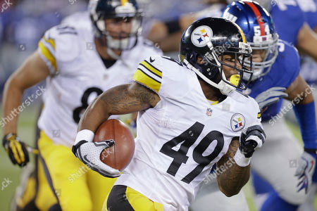 Pittsburgh Steelers running back Jordan Hall (49) runs the ball against the New York Giants in the third quarter of a preseason NFL football game, in East Rutherford, N.J