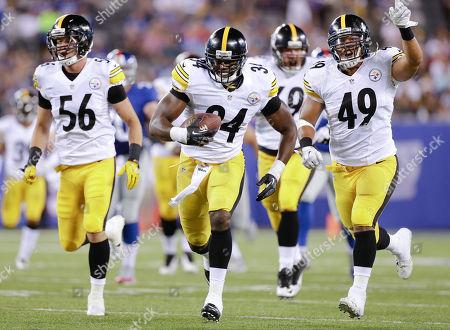Pittsburgh Steelers linebacker Howard Jones (34) runs back a New York Giants fumble for a touchdown followed by outside linebacker Jordan Zumwalt (56) and running back Jordan Hall (49) in the fourth quarter of a preseason NFL football game, in East Rutherford, N.J