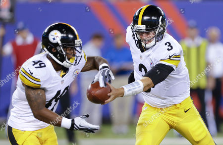 Pittsburgh Steelers quarterback Landry Jones (3) hands off the ball to Pittsburgh Steelers running back Jordan Hall (49) in the third quarter of a preseason NFL football game, in East Rutherford, N.J