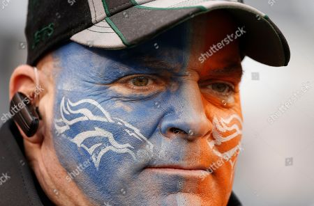 Stock Photo of Denver Broncos fan Rich Davis, from Elizabeth, N.J., watches pre-game activities on the field before the NFL Super Bowl XLVIII football game, in East Rutherford, N.J