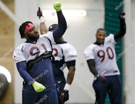 Robert Ayers, Shaun Phillips Denver Broncos defensive ends Robert Ayers (91) and Shaun Phillips (90) stretch during practice, in Florham Park, N.J. The Broncos are scheduled to play the Seattle Seahawks in the NFL Super Bowl XLVIII football game Sunday, Feb. 2, in East Rutherford, N.J