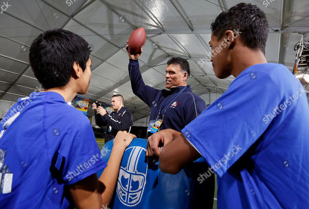 Anthony Munoz Local youth listen to Pro Football Hall of Fame offensive Tackle Anthony Munoz while participating in an NFL PLAY 60 Character Camp at the Chelsea Waterside Park, in New York. The NFL PLAY 60 Character Camp is a partnership between the NFL and the Munoz Agency, run by Munoz
