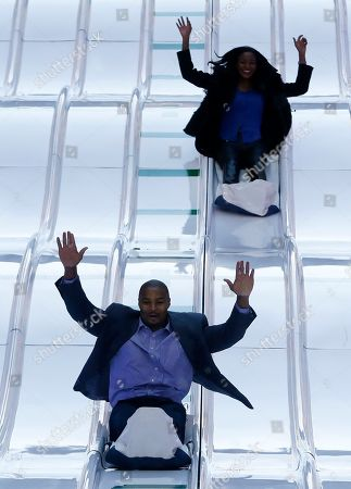 Osi Umenyiora, Leila Lopes Atlanta Falcons defensive end Osi Umenyiora, bottom, and his fiancee, Miss Universe 2011 Leila Lopes, slide down the toboggan slide during Super Bowl Boulevard festivities, in New York. The Seattle Seahawks are scheduled to play the Denver Broncos in the NFL Super Bowl XLVIII football game on Sunday, Feb. 2, in East Rutherford, N.J