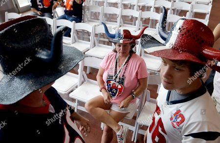 Beth Daniel Danny Morgan Houston Texans fans Beth Morgan, center, her son Daniel, right, and husband Donny, left, wait for the start of the NFL draft as they attend a Houston Texans draft day party at NRG Stadium, in Houston. The Texans have the first pick in the NFL draft