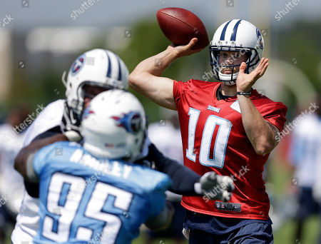 Jake Locker, Kamerion Wimbley Tennessee Titans quarterback Jake Locker (10) passes as defensive end Kamerion Wimbley (95) rushes during an NFL football training camp, in Nashville, Tenn