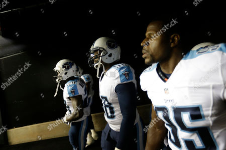 Shaun Phillips Tennessee Titans linebacker Shaun Phillips (58) and players walk to the field before the first half of an NFL preseason football game against the Atlanta Falcons, in Atlanta