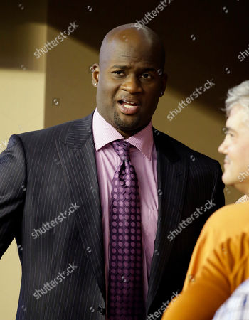 Vince Young Former Texas quarterback Vince Young visits with others in a side line suite during the second half of an NCAA college football game between Texas and UCLA, in Arlington, Texas. Police say former NFL quarterback Vince Young has been arrested on charges of drunken driving in Austin, Texas. Travis County jail records show that the 32-young former Texas star was booked shortly after midnight, on a misdemeanor charge of driving while intoxicated
