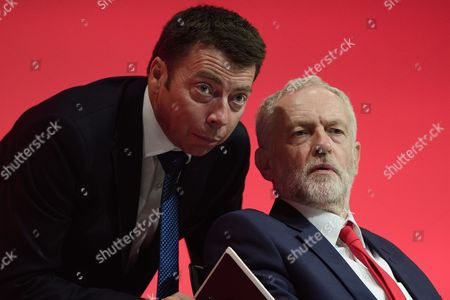 General Secretary of the Labour Party Iain McNicol and Labour leader Jeremy Corbyn on stage on day one of the Labour Party Annual Conference