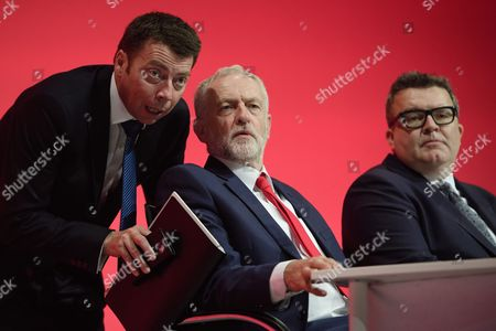 General Secretary of the Labour Party Iain McNicol, Labour leader Jeremy Corbyn and deputy leader Tom Watson on stage on day one of the Labour Party Annual Conference