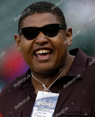 Omar Miller Actor Omar Miller laughs as he watches batting practice before a baseball game between the Los Angeles Angels and the Seattle Mariners, in Seattle