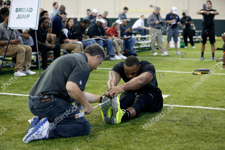 Stock Picture of Gary Mason, Mike Baugh Baylor defensive end Gary Mason has his flexibility tested by New Orleans Saints scout Mike Baugh, left, during works out for NFL scouts during a pro-day workout at Baylor University, in Waco, Texas