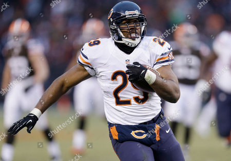 Michael Bush Chicago Bears running back Michael Bush (29) runs away from the Cleveland Browns defense on a 40-yard touchdown run in the fourth quarter of an NFL football game, in Cleveland