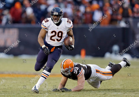 Michael Bush, Paul Kruger Chicago Bears running back Michael Bush (29) gets away from Cleveland Browns outside linebacker Paul Kruger (99) and races 40 yards for a touchdown in the fourth quarter of an NFL football game, in Cleveland
