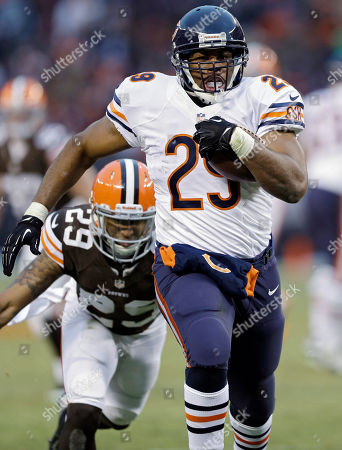 Michael Bush Chicago Bears running back Michael Bush out runs Cleveland Browns cornerback Leon McFadden on a 40-yard touchdown run in the fourth quarter of an NFL football game, in Cleveland. The Bears won 38-31