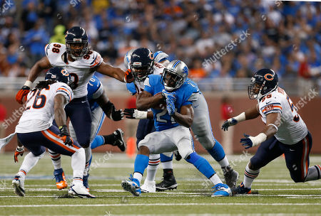 Reggie Bush Detroit Lions running back Reggie Bush (21) escapes Chicago Bears cornerback Tim Jennings (26), defensive end Corey Wootton (98), defensive lineman Landon Cohen and linebacker Lance Briggs (55) during the third quarter of an NFL football game against at Ford Field in Detroit
