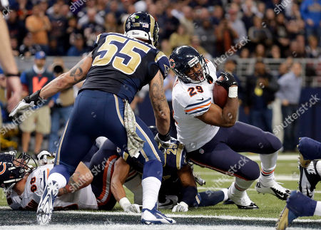 James Laurinaitis, Michael Bush Chicago Bears running back Michael Bush, right, scores on a 1-yard run past St. Louis Rams linebacker James Laurinaitis (55) during the fourth quarter of an NFL football game, in St. Louis