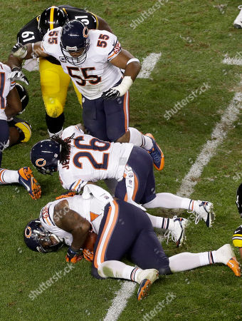 Stock Picture of Henry Melton, Tim Jennings, Lance Briggs Chicago Bears defensive tackle Henry Melton (69), bottom, recovers a fumble by Pittsburgh Steelers running back Felix Jones (23) in the third quarter of an NFL football game in Pittsburgh