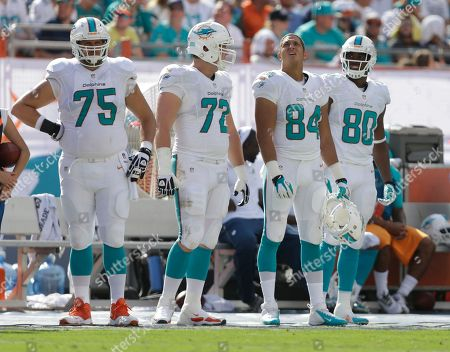 Nate Garner, Will Yeatman, Michael Egnew, Dion Sims Miami Dolphins guard Nate Garner (75), tackle Will Yeatman (72), tight ends Michael Egnew (84) and Dion Sims (80) wait their turn during the second half of an NFL football game against the Buffalo Bills, in Miami Gardens, Fla