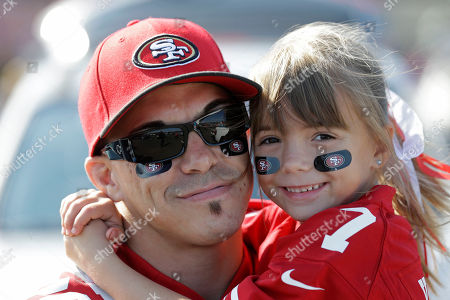 Chris Potter, Cailee Potter San Francisco 49ers fan Chris Potter, left, holds his seven-year-old daughter Cailee while tailgating before an NFL preseason football game against the Denver Broncos, in San Francisco
