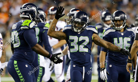 Jeron Johnson Seattle Seahawks' Jeron Johnson (32) and Michael Brooks, left, celebrate a play against the Denver Broncos in the second half of a preseason NFL football game, in Seattle