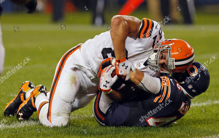 Stock Image of Dan Gronkowski, Tom Nelson Cleveland Browns tight end Dan Gronkowski, top, and Chicago Bears defensive back Tom Nelson battle for a possession after Gronkowski made a touchdown reception during the second half of a preseason NFL football game, in Chicago. The Browns won 18-16