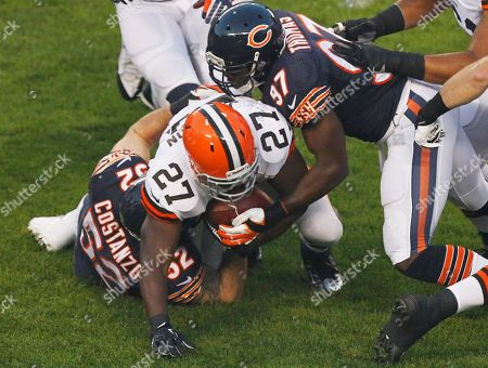 Blake Costanzo, J.T. Thomas, Brandon Jackson Chicago Bears linebackers Blake Costanzo (52) and J.T. Thomas (97) stop Cleveland Browns running back Brandon Jackson (27) during the first half of a preseason NFL football game, in Chicago