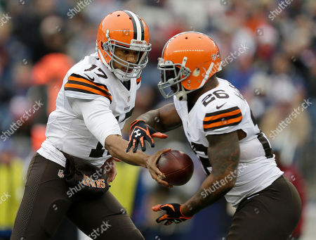 Stock Photo of Jason Campbell, Willis McGahee Cleveland Browns quarterback Jason Campbell, right, hands off to running back Willis McGahee (26) in the first quarter of an NFL football game against the New England Patriots, in Foxborough, Mass