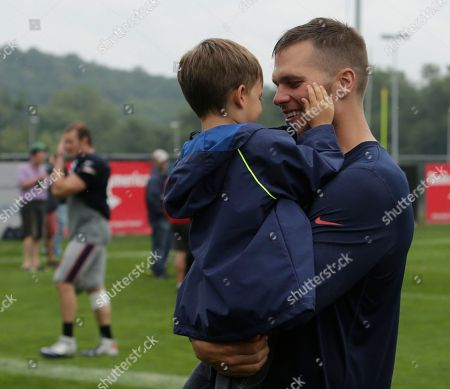 Tom Brady, Benjamin Brady New England Patriots quarterback Tom Brady with his son Benjamin Brady after a joint workout with the Tampa Bay Buccaneers at NFL football training camp, in Foxborough, Mass