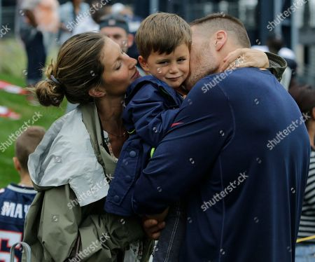 Tom Brady, Gisele Bundchen, Benjamin Brady New England Patriots quarterback Tom Brady and his wife Gisele Bundchen with their son Benjamin Brady after a joint workout with the Tampa Bay Buccaneers at NFL football training camp, in Foxborough, Mass