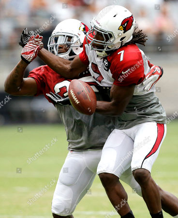 Javier Arenas, Tyler Shaw Arizona Cardinals' Javier Arenas, left breaks up a pass intended for Tyler Shaw, right, during an NFL football training camp, in Glendale, Ariz