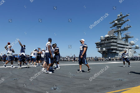 Nick Hardwick San Diego Chargers center Nick Hardwick, left, throws a pass as the Chargers joke around during NFL football training on the flight deck of the USS Ronald Reagan aircraft carrier, in Coronado, Calif. The Chargers play their final preseason game Thursday against the San Francisco 49ers