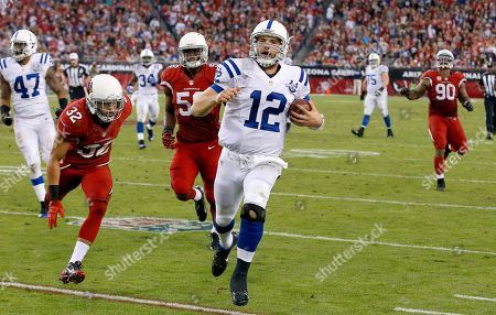 Stock Image of Andrew Luck, Tyrann Mathieu, Daryl Washington, Darnell Dockett, Weslye Saunders Indianapolis Colts' Andrew Luck (12) runs for a first down as Arizona Cardinals' Tyrann Mathieu (32), Daryl Washington (58), and Darnell Dockett give chase, while Colts' Weslye Saunders (47) looks down the field during the second half of an NFL football game, in Glendale, Ariz. The Cardinals defeated the Colts 40-11