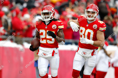Jamaal Charles, Anthony Fasano Kansas City Chiefs running back Jamaal Charles (25) celebrates a touchdown with Anthony Fasano (80) during the first half of an NFL football game at Arrowhead Stadium in Kansas City, Mo