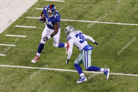 Stock Picture of Brandon Jacobs Dallas Cowboys strong safety Jeff Heath (38) tackles New York Giants' Brandon Jacobs (34) during the first half of an NFL football game, in East Rutherford, N.J