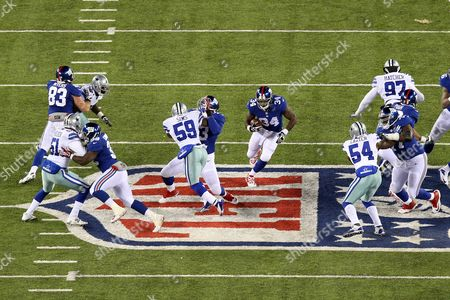 Brandon Jacobs New York Giants running back Brandon Jacobs (34) runs with the ball against the Dallas Cowboys during the first half of an NFL football game, in East Rutherford, N.J