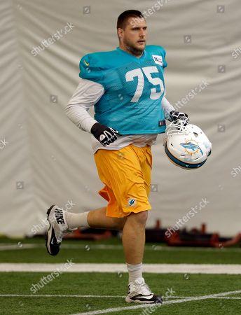 Nate Garner Miami Dolphins guard Nate Garner (75) runs during an NFL football practice, in Davie, Fla
