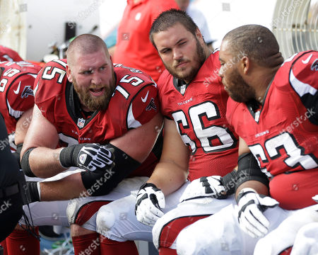 Peter Konz, Garrett Reynolds, Justin Blalock Atlanta Falcons guards Peter Konz (66) Garrett Reynolds (75) and Justin Blalock (63) sit on the sidelines during the first half of an NFL football game against the Miami Dolphins, in Miami Gardens, Fla
