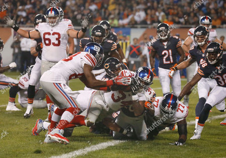 Brandon Jacobs New York Giants running back Brandon Jacobs (34) rolls into the end zone for a touchdown in the first half of an NFL football game against the Chicago Bears, in Chicago