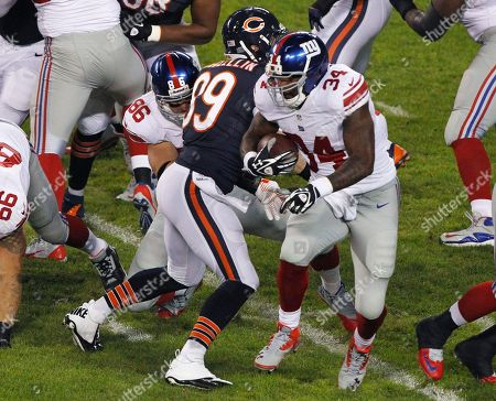 Brandon Jacobs, Shea McClellin New York Giants running back Brandon Jacobs (34) rushes past Chicago Bears defensive end Shea McClellin (99) In the first half of an NFL football game, in Chicago