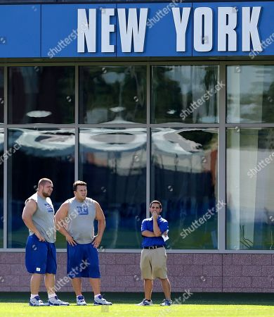 David Baas, Chris Snee New York Giants center David Baas, left, stands next to guard Chris Snee as they watch teammates run drills during NFL football training camp in East Rutherford, N.J