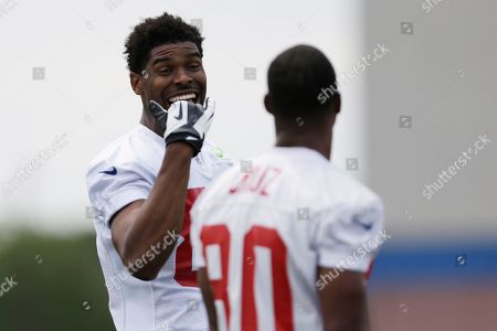 Ramses Barden, Victor Cruz New York Giants wide receivers Ramses Barden, left, and Victor Cruz talk during NFL football camp in East Rutherford, N.J