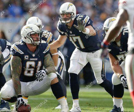 Philip Rivers, Nick Hardwick San Diego Chargers quarterback Philip Rivers changes something in his play as center Nick Hardwick listens during the second half of an NFL football game, in San Diego