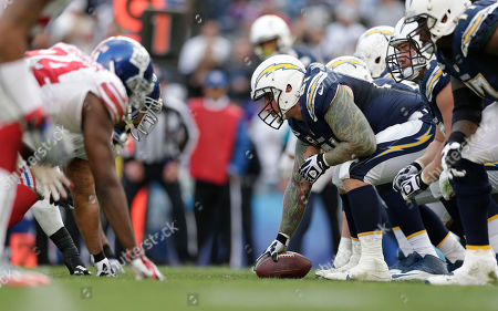 Stock Photo of Nick Hardwick San Diego Chargers center Nick Hardwick, right gets ready to start a play against the New York Giants in the first half during an NFL football game, in San Diego