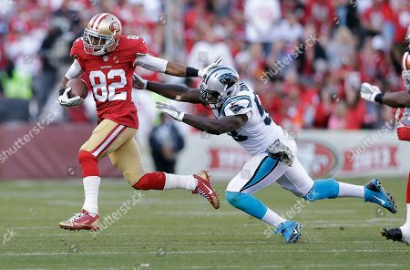 Mario Manningham, Thomas Davis San Francisco 49ers wide receiver Mario Manningham (82) runs past Carolina Panthers outside linebacker Thomas Davis during an NFL football game in San Francisco. Manningham, one of the New York Giants' most productive receivers from 2008-2011, will rejoin the team
