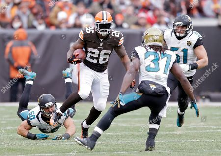 Willis McGahee, Russell Allen Cleveland Browns running back Willis McGahee (26) escaper Jacksonville Jaguars outside linebacker Russell Allen (50) to run for a first down in the third quarter of an NFL football game, in Cleveland